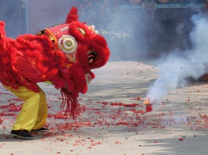 Lion dancing with fireworks