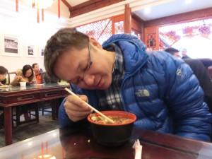 young men eating Jiaozi